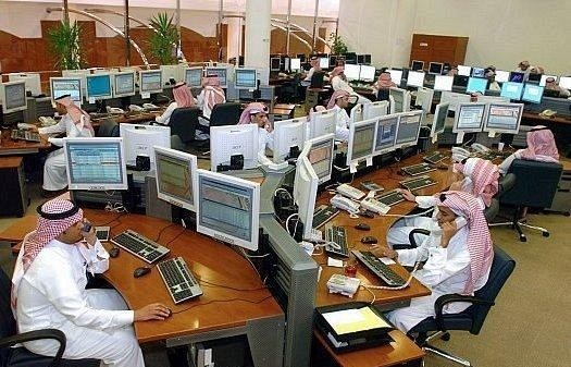 سوق الأسهم يغلق منخفضاً عند 7166 نقطة